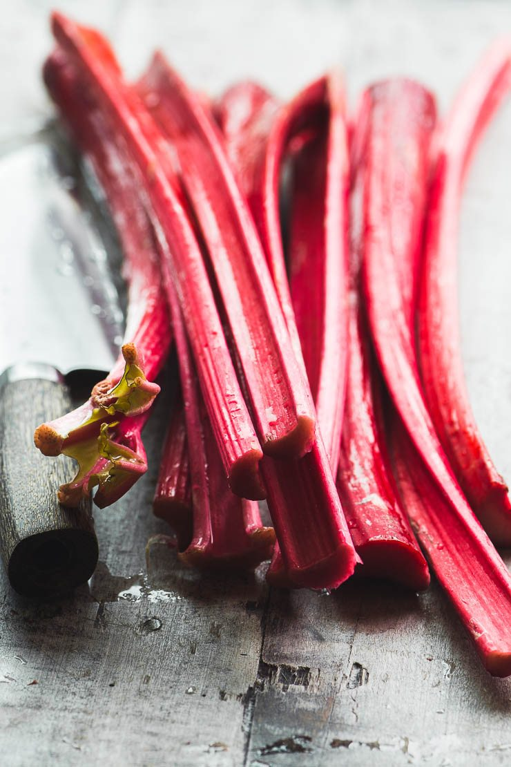 stalks of fresh rhubarb ready to be chopped for a rhubarb crisp