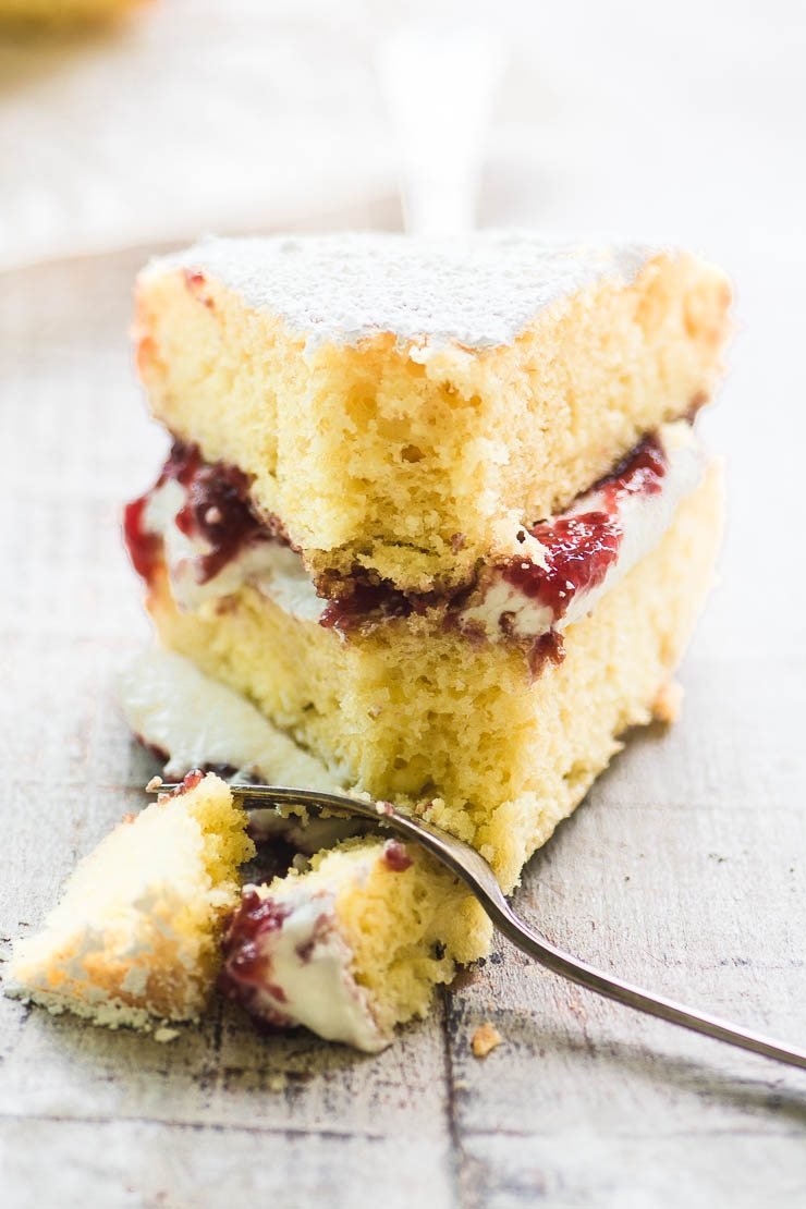 A slice of Victoria Sponge Cake with a fork