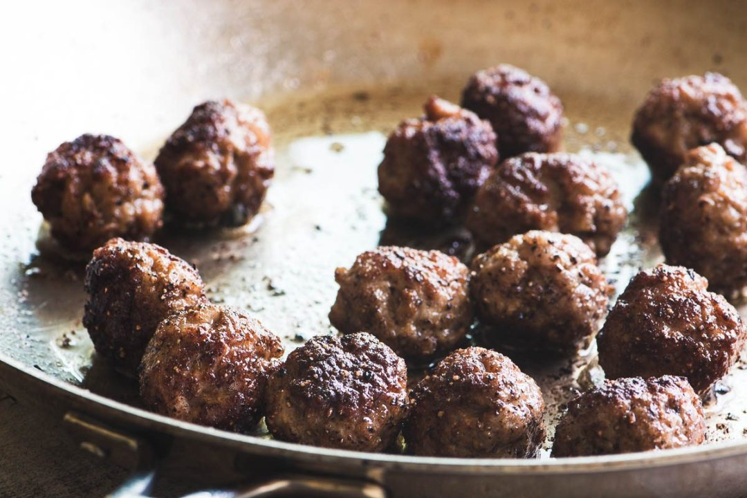 Sausage meatballs frying in a pan for Jamie Oliver's Easy Sausage Carbonara