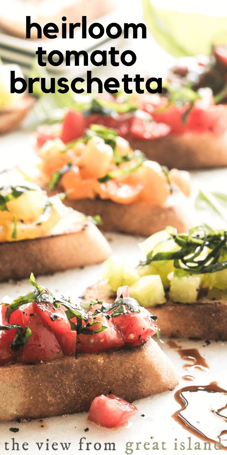 Heirloom Tomato Bruschetta ~ an easy healthy Italian appetizer made with a crusty baguette, lots of heirloom tomatoes, and fresh basil #appetizer #bread #toast #tomatoes #Italian #easy #tapas #mezze #caprese #balsamic #crostini