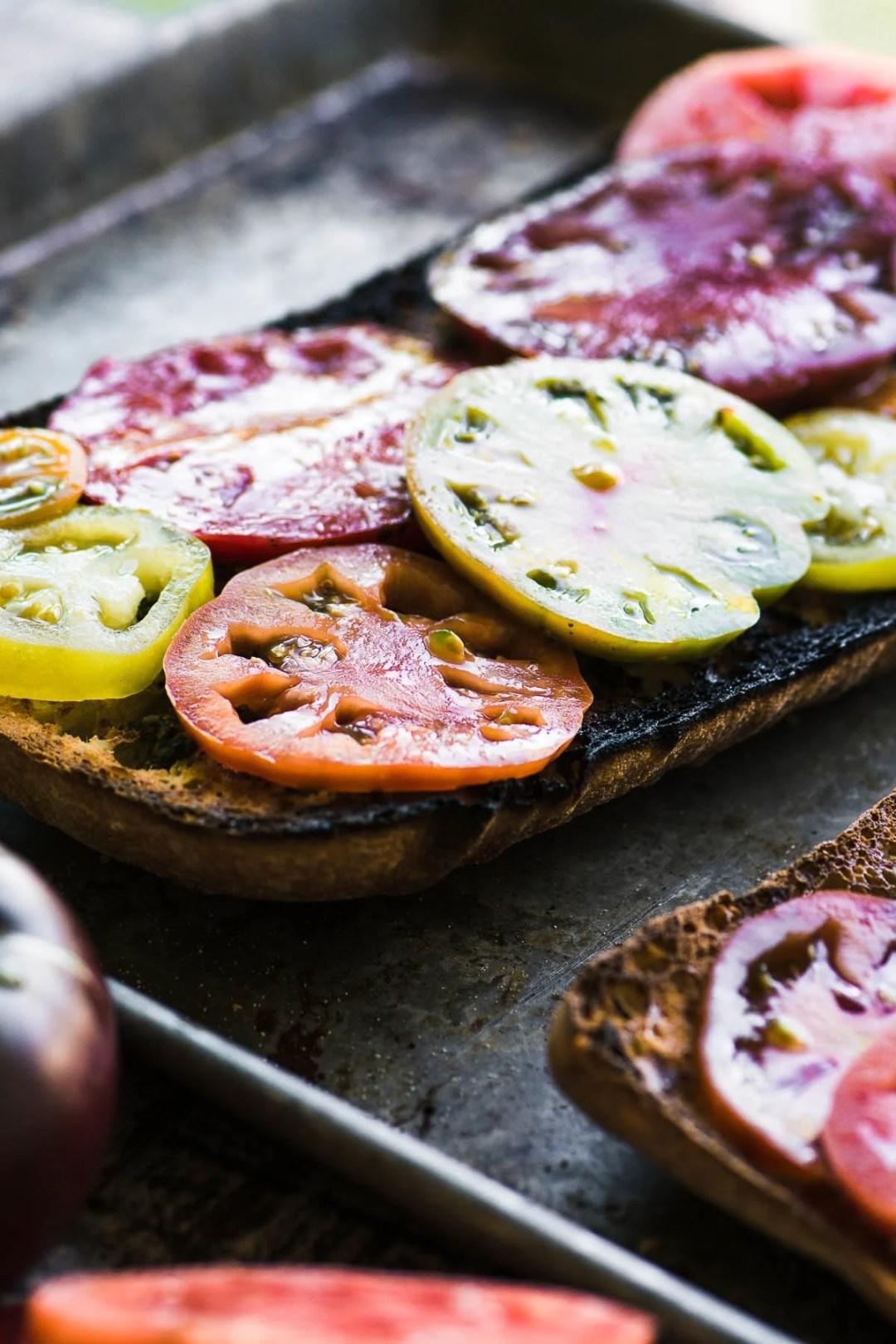Making heirloom tomato toast on a baking sheet