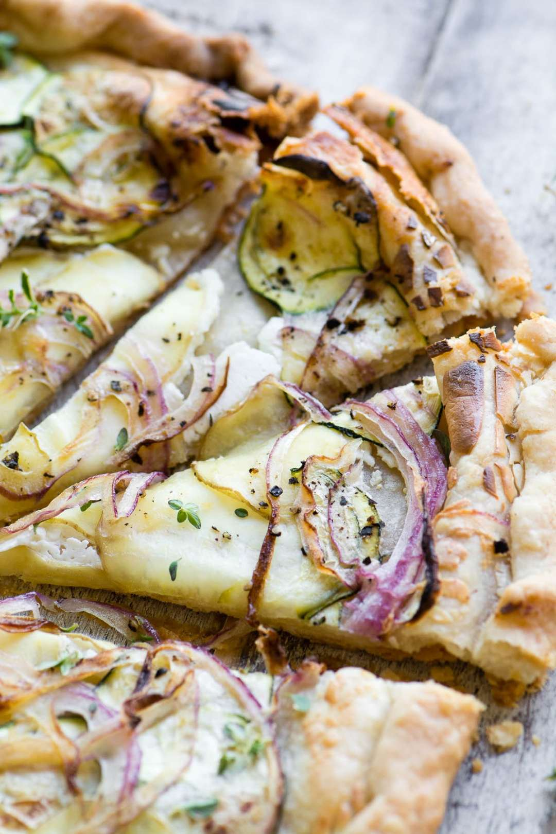 goat cheese and summer squash tart, sliced