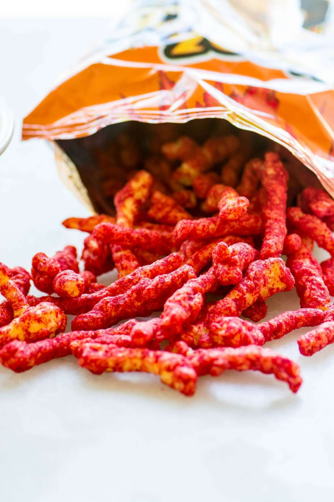 flamin' hot cheetos spilling out of the bag