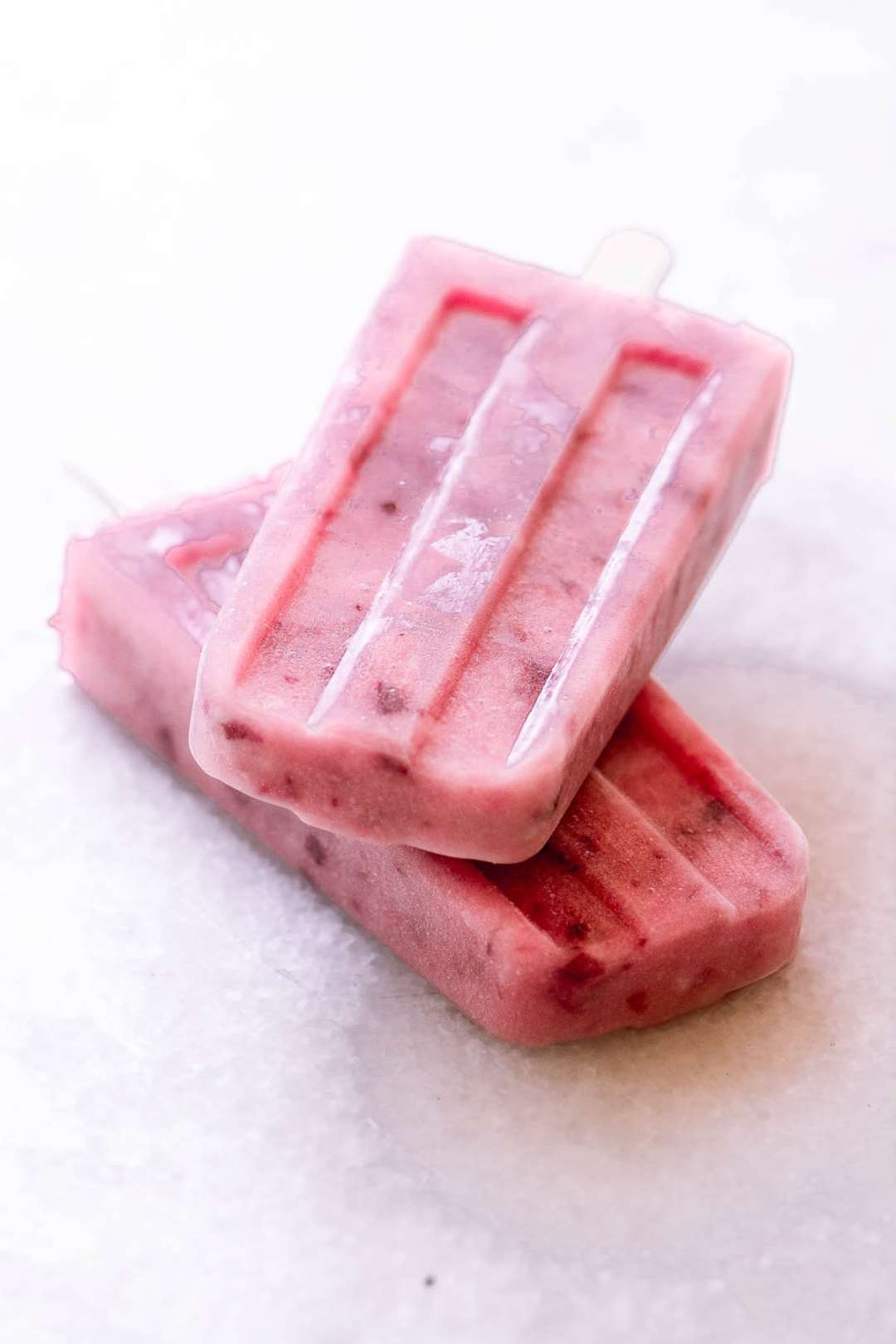 a stack of two white peach popsicles