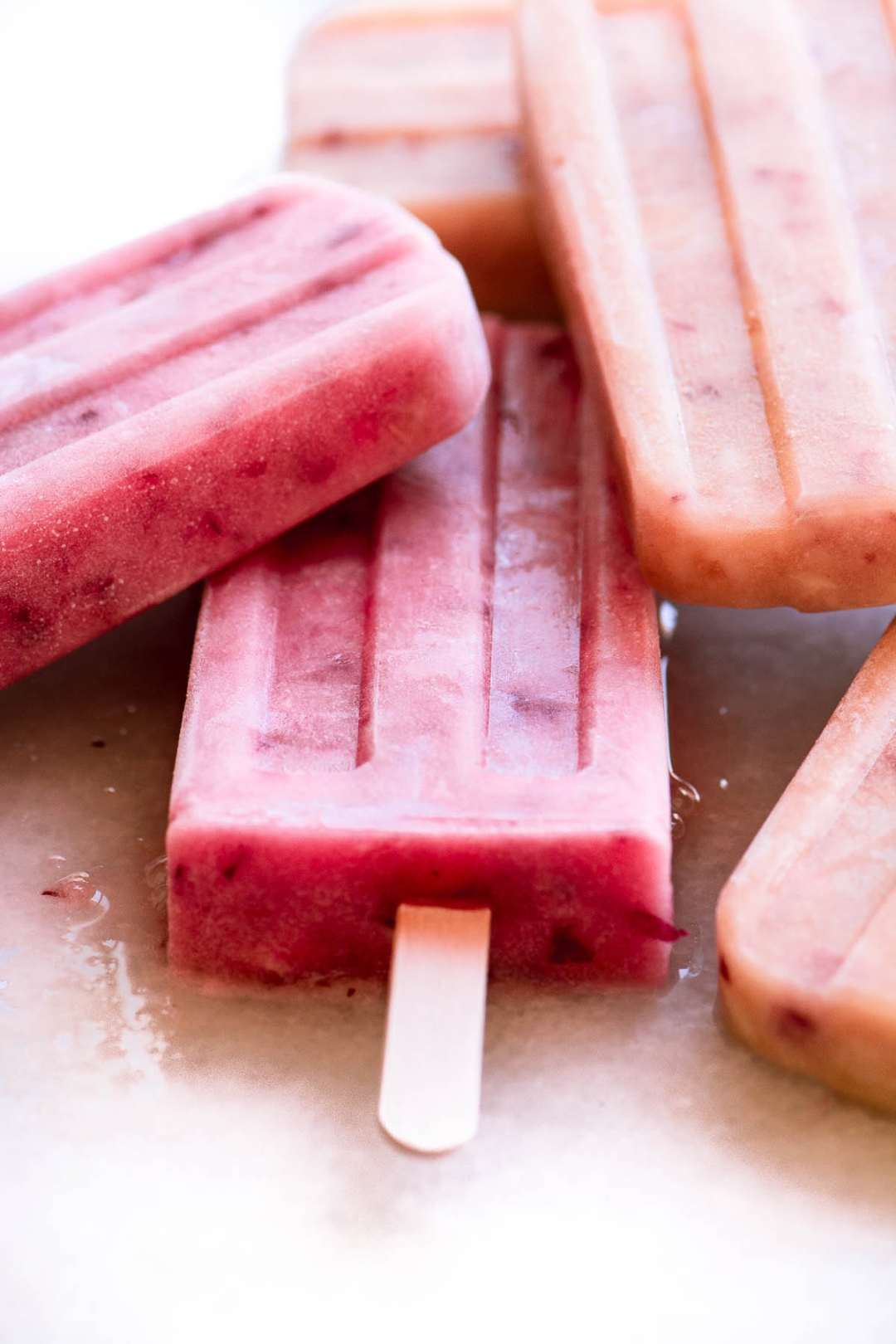 a stack of white peach popsicles