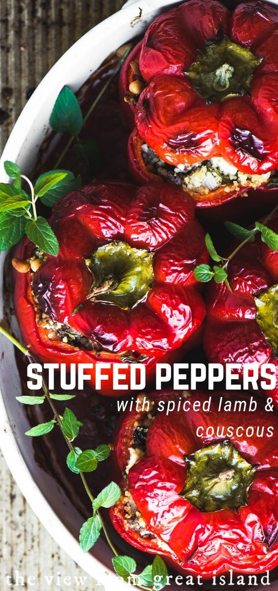 Spiced Lamb and Couscous Stuffed Peppers ~ this classic comfort food gets an exotic Middle Eastern makeover with ground lamb and couscous. #recipe #easy #lamb #couscous #redpeppers #bellpeppers #dinner #groundlamb #comfortfood #maincourse