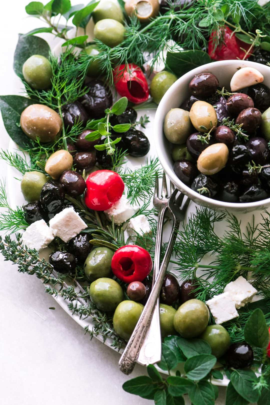 Festive Olive Herb Wreath appetizer on a marble counter