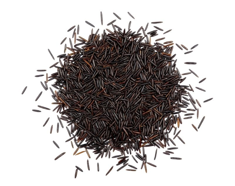 Wild Rice spilled on a white surface