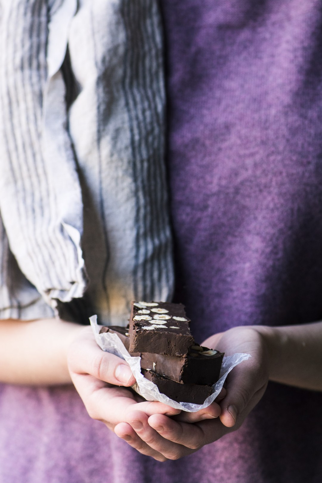 Holding a stack of chocolate hazelnut torrone slices