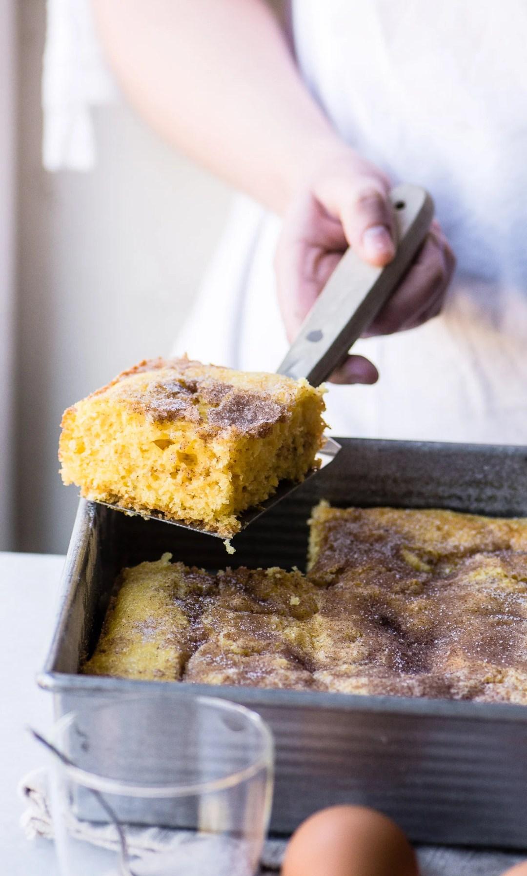 Cutting a piece of super easy cinnamon coffee cake