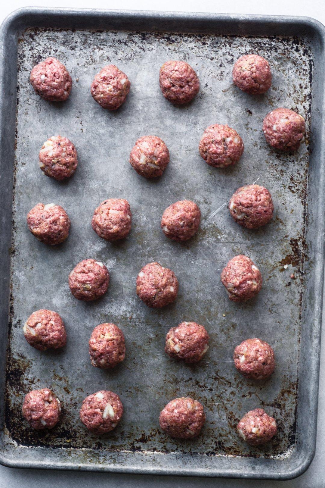a tray of Salisbury meatballs ready to bake