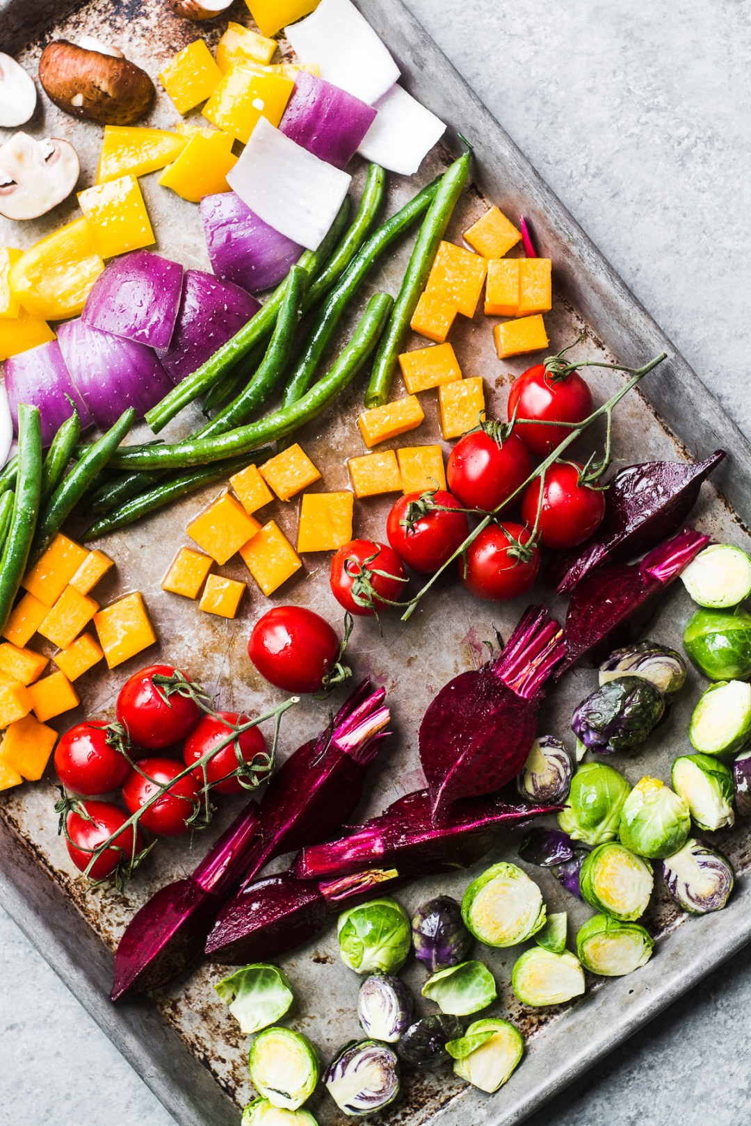 A tray of rainbow vegetables waiting to be roasted for a roasted vegetable winter bliss bowl