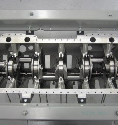 as with most of the in line engines of this period the crankcase is of cast aluminium construction and is in 4 parts the upper lower front and rear  [ 1280 x 960 Pixel ]