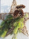 Grapevine stars adorned with fresh greens and pine cones decorate the workshop/garage.