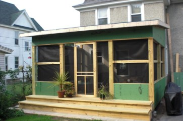 It has become an enclosed screened porch that will eventually become a four-season room. The enclosed area offers more privacy from second story neighbors. I have created my own viewing room of the garden!
