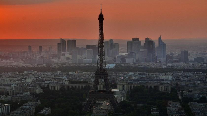 The Eiffel Tower under a dark red sky