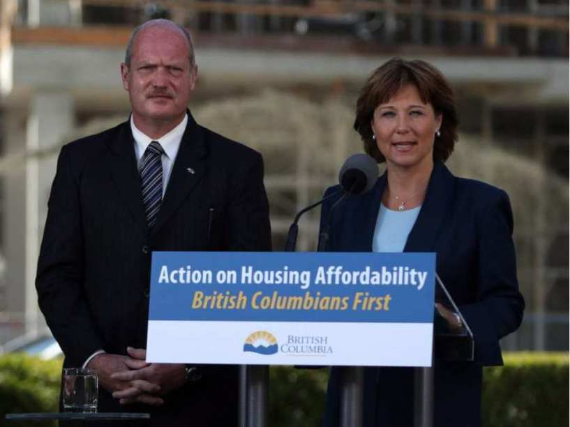 Christy Clark and Mike DeJong made a sign to show they are serious about housing.