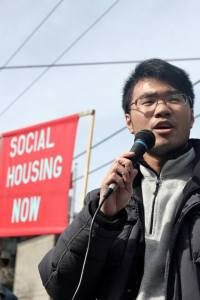 King-mong Chan speaking at a rally.
