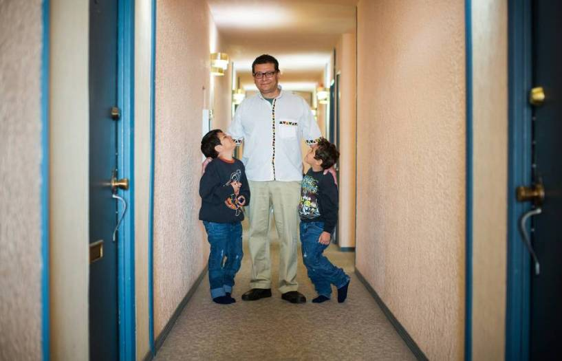Martin in the hallway of his old building with his two sons.