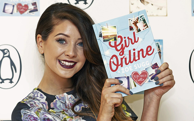 Zoe Sugg with her first book, Girl Online (Reuters/Luke MacGregor)