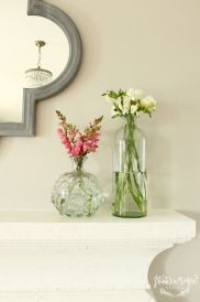 We love the look of fresh flowers on the mantle. It has us dreaming of spring.