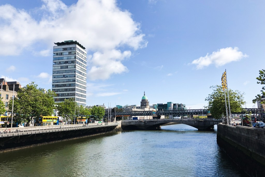 The River Liffey which runs through Dublin, with a newly built high rise on one side.