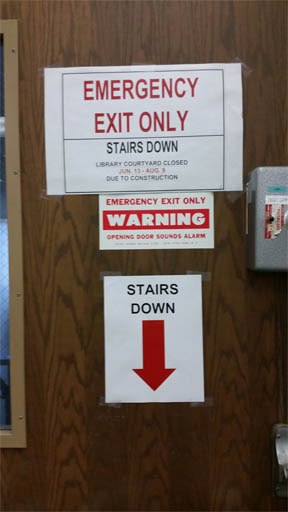 clear, typed sign for stairs
