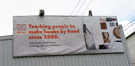 San Francisco Center for the Book billboard saying, Teching people to make books by hand since 1996.