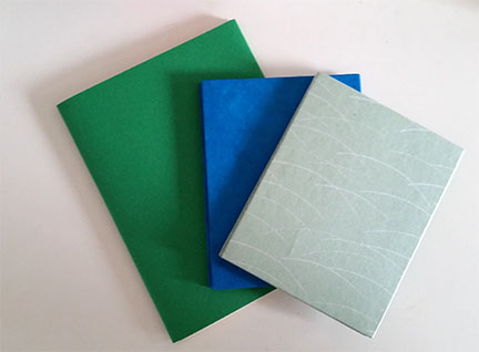 photograph of three booklets made in a workshop