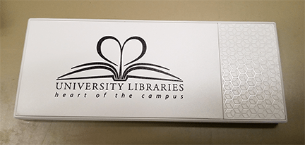 photograph of power bank with library's logo on it