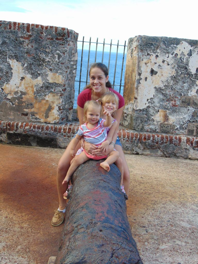 playing on a canon in el morro in viejo san juan puerto rico