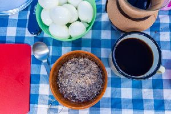 peak sherpa tsampa barley cereal with coffee and boiled eggs breakfast while camping