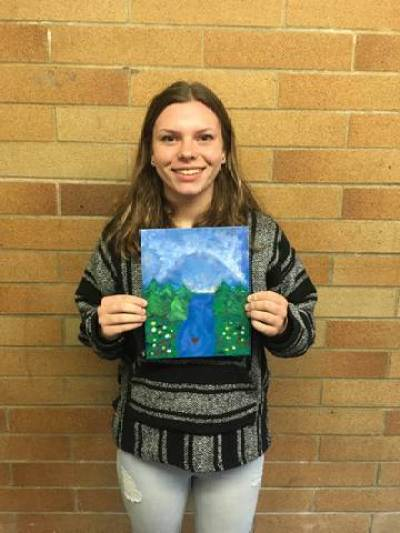 kula for a cause girl holding a painting river