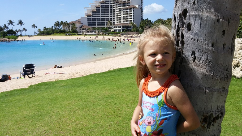 Kids at Ko'Olina Lagoon beach. Posted on a travel guide that features the best things to do with kids on Oahu, Hawaii.