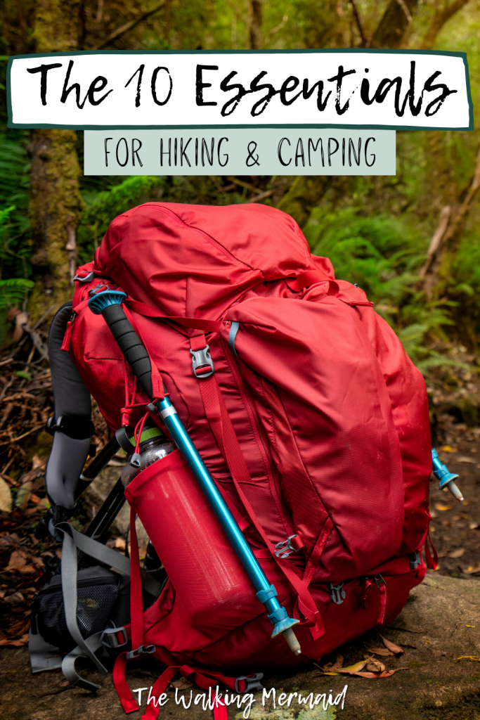Red hiking backpacking backpack with water bottle and trekking poles. Posted on a blog post that talks about the ten essentials for camping and hiking.