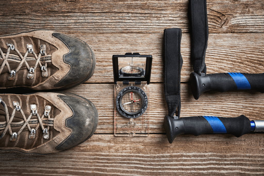 hiking boots, trekking poles, and a compass for navigation. ten essentials for hiking and camping