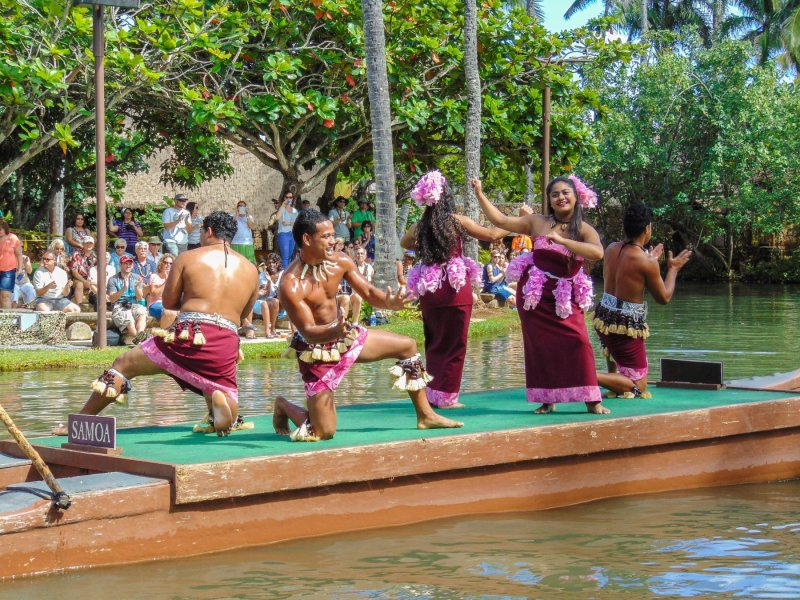 Samoans performing native dances during the canoe pageant event at The Polynesian Cultural Center attraction in Oahu, Hawai'i.