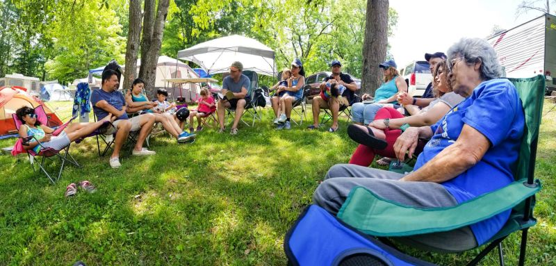 A group of campers sitting altogether and talking. Rules for Campers - Group Camping