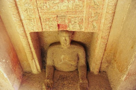 seated in tomb