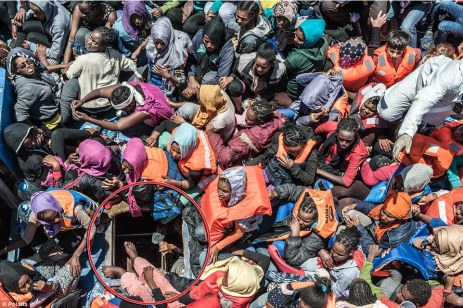 Dangerous: The migrants were found sitting virtually on top of one another on the upper deck, while even more were crammed in below using this tiny hatch