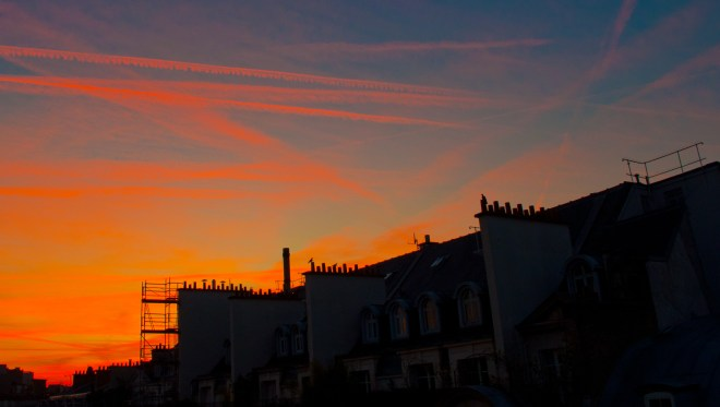 Sunset over Paris rooftops
