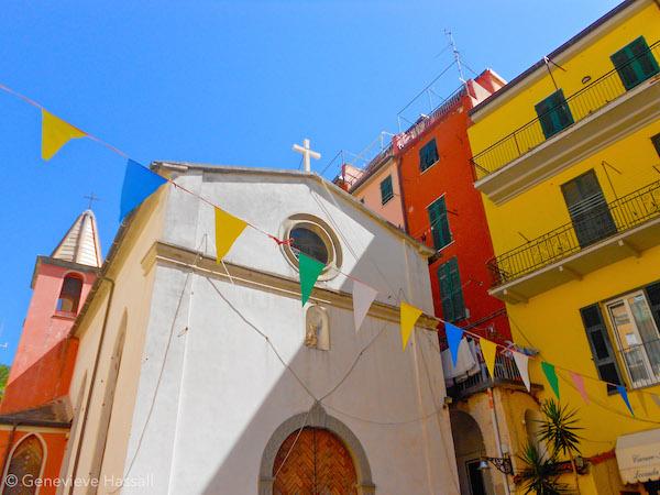 Church and flags in Riomaggiore Cinque Terre