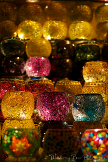 Glass votive candle holders resemble precious jewels in a cave.