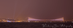 The Bosphorus Bridge glows in the distance with it's many lights that change pattern and color.