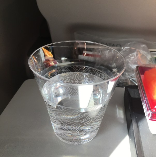 Qatar Airways Economy class review | Qatar Airways Economy class food | Water glass at Doha Hamid International Airport