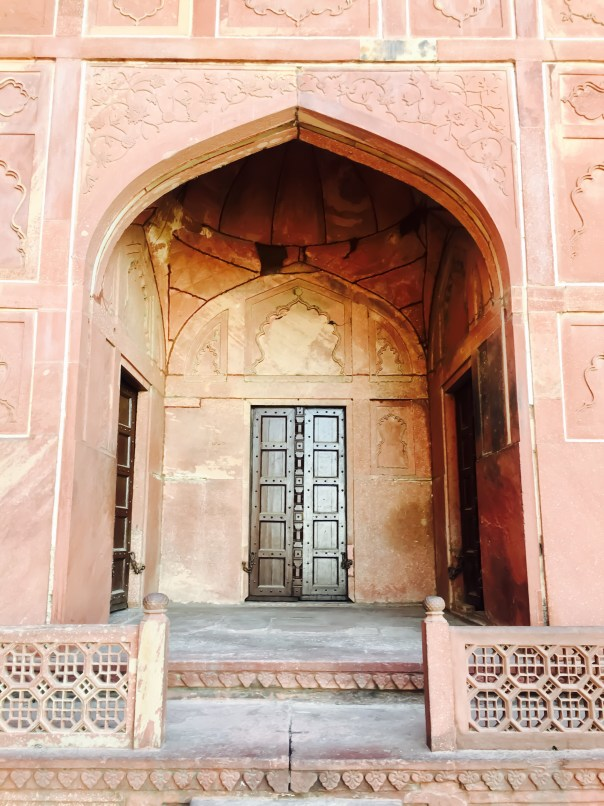Door at Jawab Mahal mirroring Taj Mahal