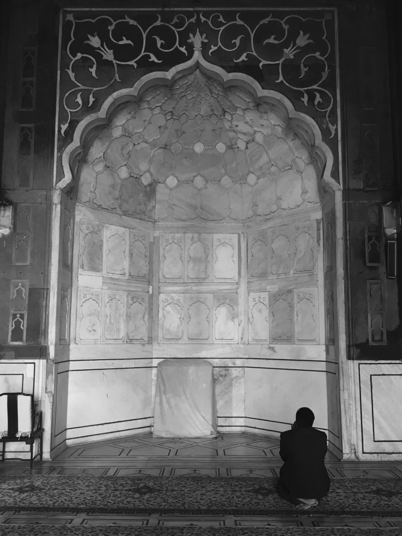 A person offering prayer at Jama Masjid, Delhi