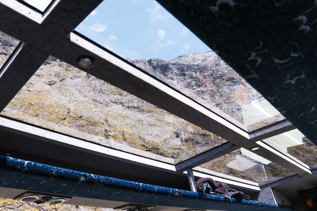 With JUCY you can go to Milford Sound in a glass roof coach.
