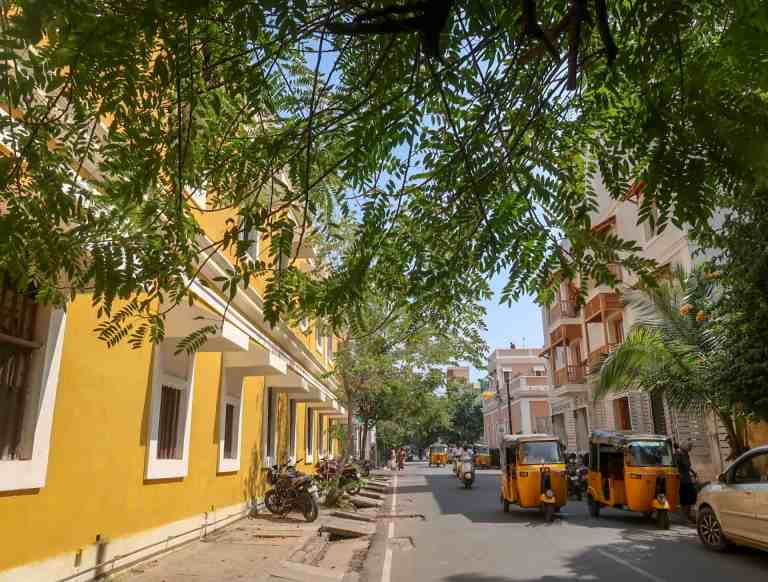 yellow building and green streets of pondicherry | best places to visit in India