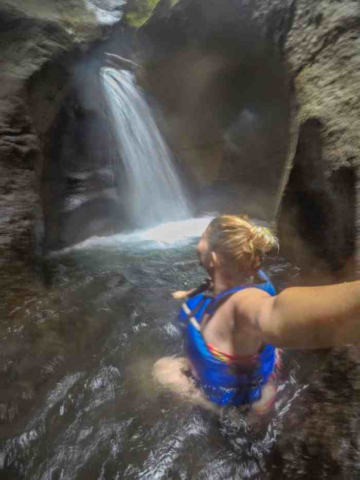 titou gorge waterfall ellie quinn in blue lifejacket | dominica day tours